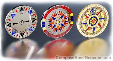 Compass Rose Geocoins in a row